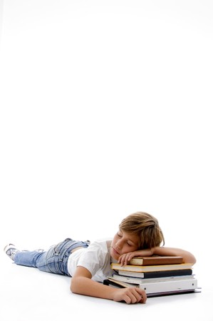 front view of boy sleeping on books  against white background photo