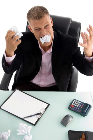young angry businessman with papers in an office  photo