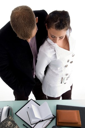 standing business couple looking at diary in an office  photo