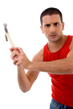 handsome man holding hammer on an isolated white background photo