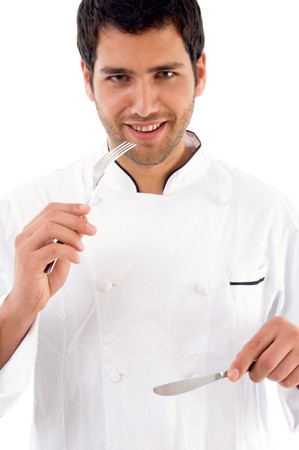 portrait of young male chef showing eating etiquettes against white background photo
