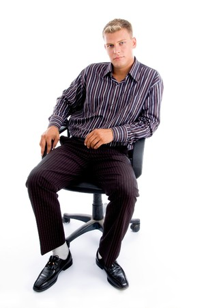 full pose of stylish successful person sitting on the chair against white background photo