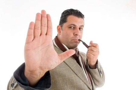 stopping: man with a stopping gesture isolated on white background Stock Photo