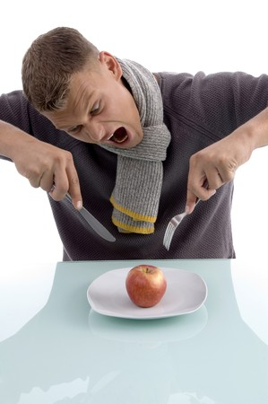 man going to eat apple with fork and knife on an isolated white background Stock Photo - 3995044
