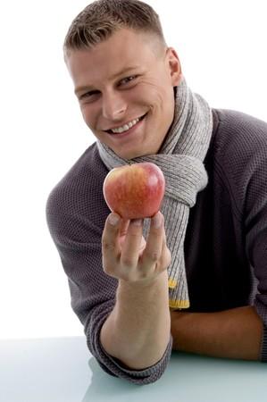 portrait of smiling man holding apple against white background Stock Photo - 3995016