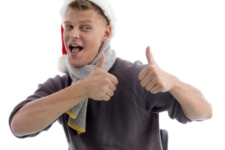 smiling man with christmas hat showing thumbs up with both hands on an isolated background Stock Photo - 3995049