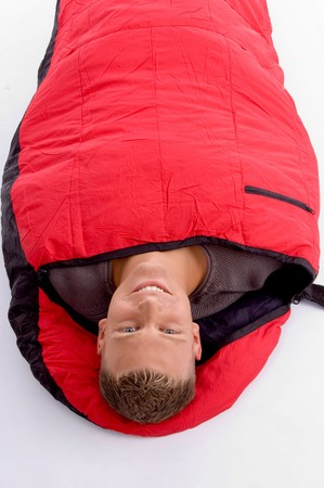 sleeping bag: man taking rest in his sleeping bag on an isolated background