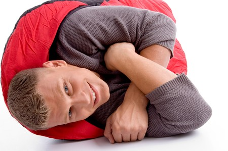 sleeping bag: man in sleeping bag lying on an isolated white background Stock Photo