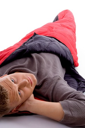 sleeping bag: attractive man posing with red sleeping bag and looking at camera with white background Stock Photo