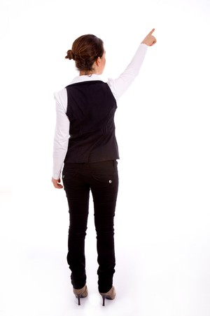 backpose of indictaing businesswoman on an isolated white background photo