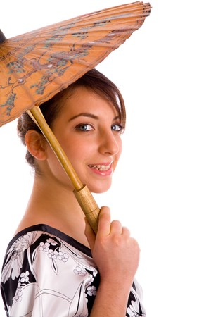 side view of smiling chineese woman holding an umbrella against white background photo