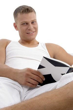 smart fellow interested in reading books in bed photo