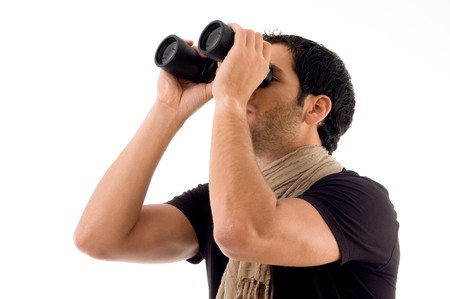 side pose of man looking through binocular on an isolated background photo