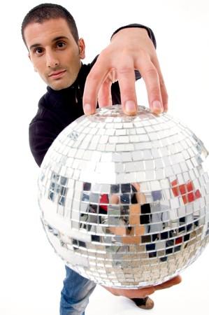 ball like: man holding disco ball like a globe on an isolated background