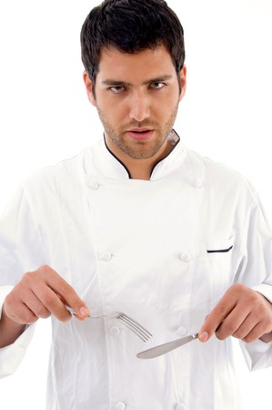 portrait of young male chef showing eating etiquettes against white background Stock Photo - 3997242