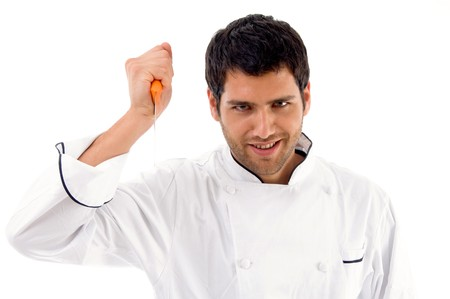 portrait of young male chef holding dagger against white background photo