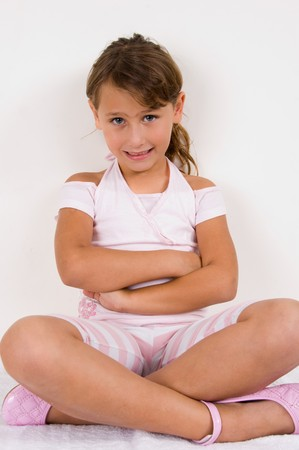 smiling girl with crossed arms and legs photo