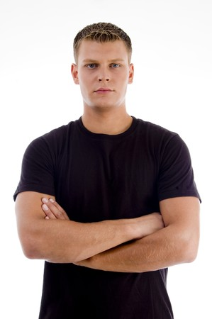 handsome male with crossed arms on an isolated background Standard-Bild