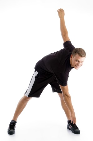 handsome muscular guy doing exercise on an isolated background Stock Photo - 3998299