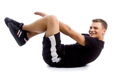 handsome muscular guy doing crunches against white background Stock Photo - 3998422