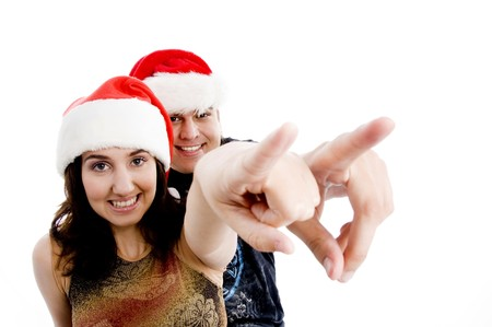 portrait of pointing couple with christmas hat with white background photo