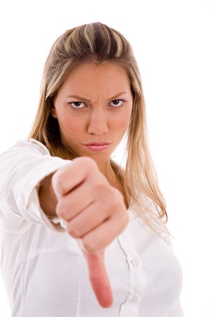 26: portrait of young boss showing thumb down on an isolated white background Stock Photo