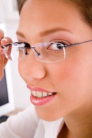 26: close up of businesswoman holding eyewear in an office