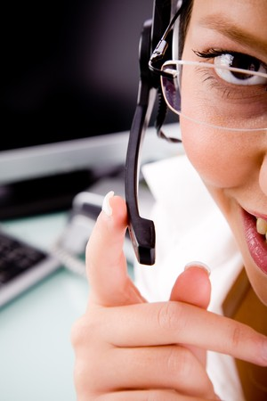 care providers: top view of smiling service provider holding microphone in an office