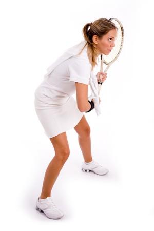 jugando tenis: vista lateral de jugador de tenis en un aislado fondo Foto de archivo