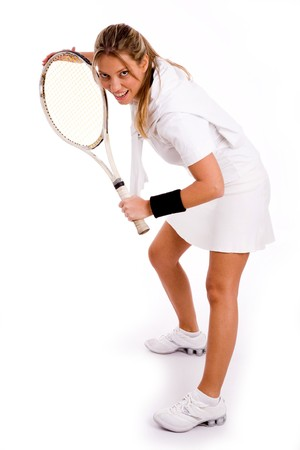 front view of young tennis player on an isolated white background photo