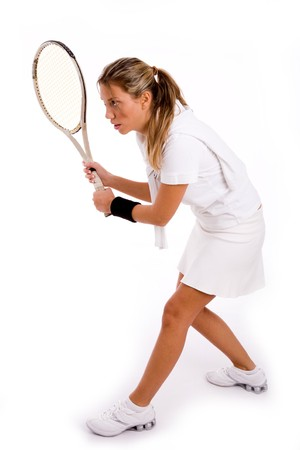side view of young player ready to play tennis on an isolated white background photo