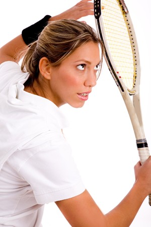 side view of young woman ready to play tennis with white background Stock Photo - 3998629