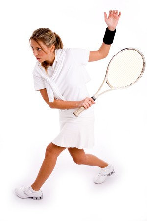 26: side view of adult tennis player playing tennis on an isolated white background