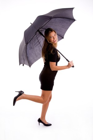 26: side view of sexy woman holding umbrella on an isolated white background Stock Photo
