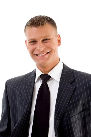 portrait of smiling handsome businessman against white background Standard-Bild