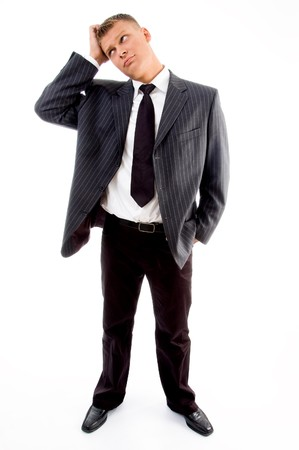 standing young confused businessman against white background