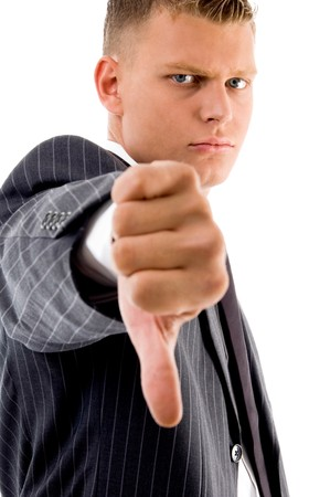 side pose of businessman with thumbs down with white background photo