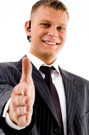 friendly businessman offering handshake against white background photo