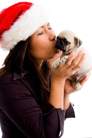 female with christmas hat and kissing puppy against white background Stock Photo - 4022244