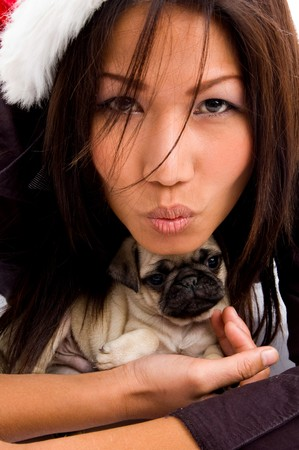 portrait of woman with christmas hat and puppy on an isolated background photo