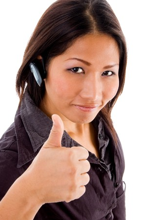21: young female service provider with thumbs up wearing hands free cellphone device  Stock Photo