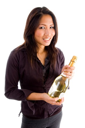 smiling asian woman holding champaign bottle on an isolated background photo