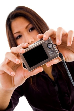 attractive asian woman holding camera on an isolated background photo