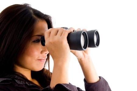beautiful asian female looking through binocular with white background photo