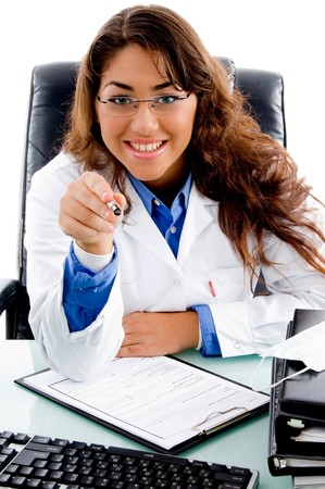 portrait of smiling doctor pointing with pen in an office photo