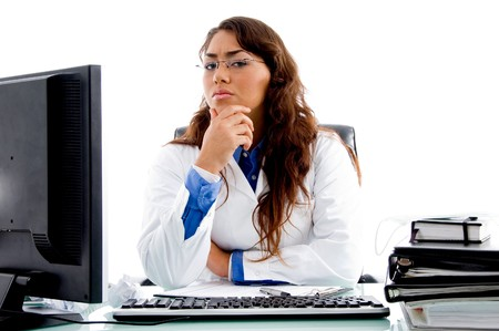 medical professional looking at camera in an office photo
