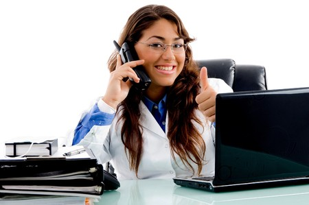 smiling doctor with thumbs up in an office Standard-Bild