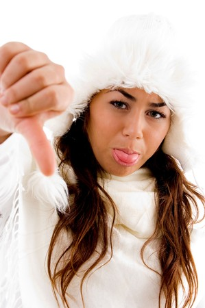 woman showing thumbs down on an isolated white background photo