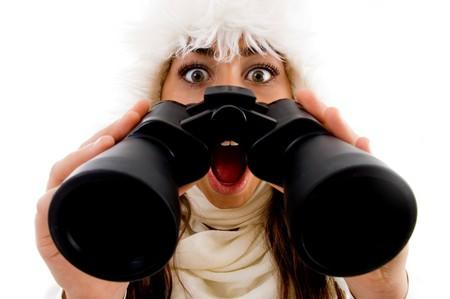 shocked female with binocular against white background photo
