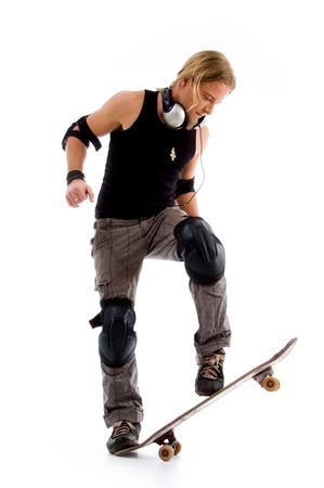male riding on skate board against white background Standard-Bild